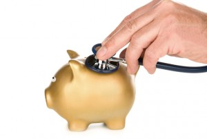 Piggy bank examined with stethoscope