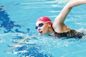 young girl swims freestyle