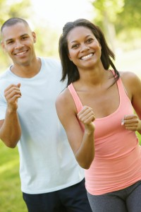 Young African American Couple Jogging In Park