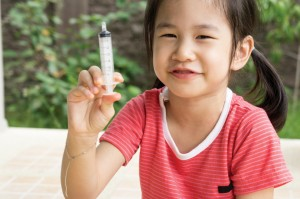 Asian child girl childhood medicine cold fever concept