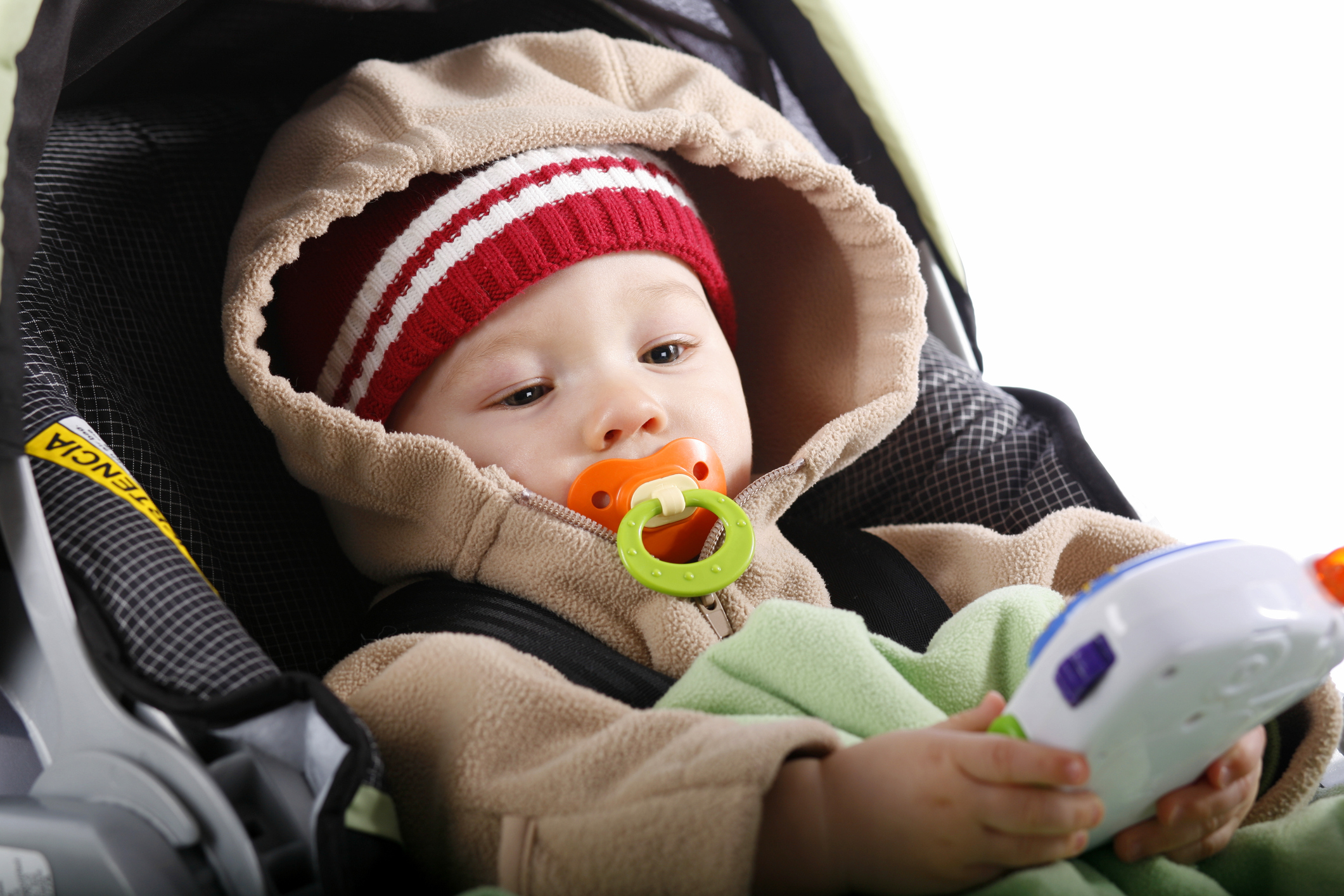 Baby in car seat with toy