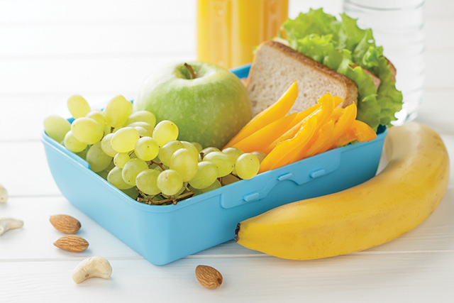 Concept of healthy food for school or work on white wooden background.